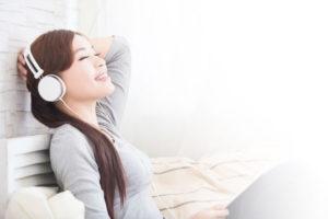 Girl using headphones to listen to premium audio