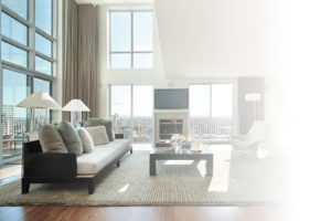 Motorized shades in luxury condo with fireplace
