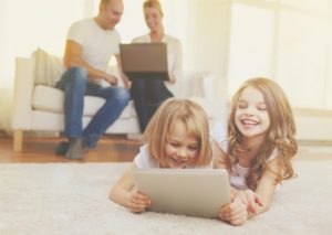 Family using smart home features on tablet