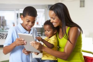 Family using smart home tablet